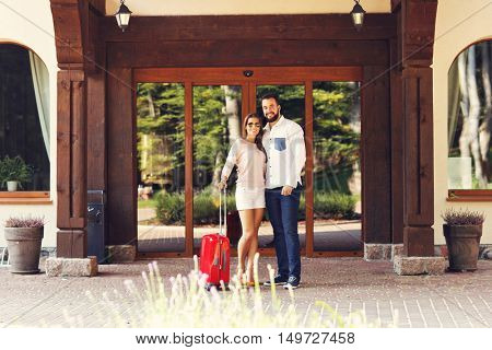 Picture of young couple entering hotel