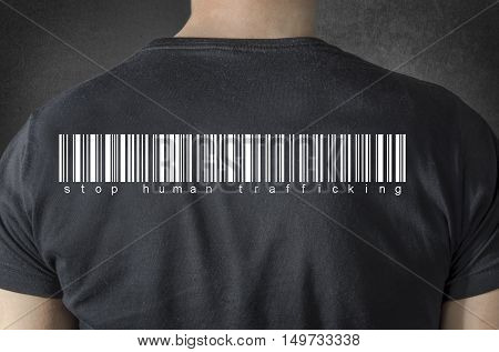 Stop human trafficking tittle and barcode on black t-shirt. Back view.
