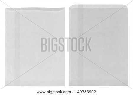 Closeup of wrinkly thin white grocery paper bag, blank front and back isolated on white background