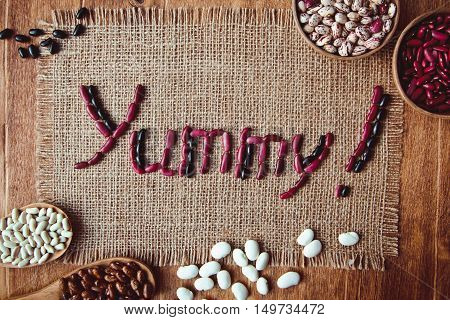Beautiful Multi-colored Beans In Wooden Spoons On A Background Of Burlap C Posted From The Bean Of T