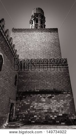 Cairo, Egypt - March 21, 2015: Minaret of Al Hakem mosque (The Enlightened Mosque) is a major Islamic religious site in Cairo Egypt. named after Imam Al-Hakim bi-Amr Allah (985-1021) the sixth Fatimid caliph16th Fatimid/Ismaili Imam and the first to be bo