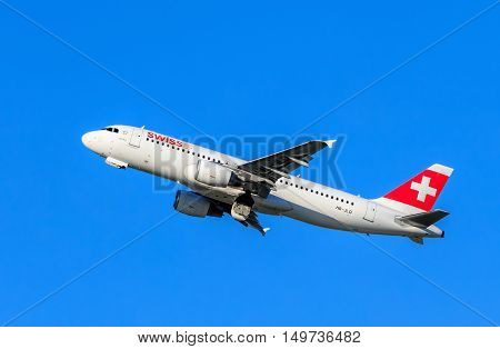 Kloten Switzerland - 30 September 2016: Swiss Airbus A-320 after take off in the Zurich Airport (also known as the Kloten Airport). Swiss International Air Lines is the flag carrier airline of Switzerland and a member of the Star Alliance.