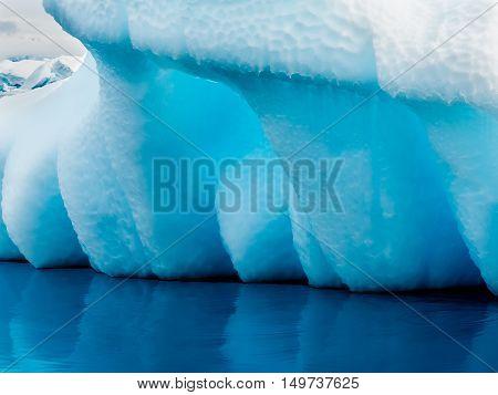 A stunning blue iceberg near Yalour Islands Antarctica