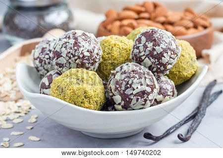 Healthy homemade paleo chocolate energy balls with rolled oats nuts dates and chia seeds horizontal
