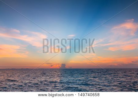 Beautiful sky after sunset over seacoast skyline, natural landscape background