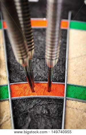 Three Darts Hitting Perfect 180 Score On Dart Board, Close Up