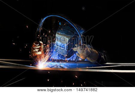 inert-gas-shielded arc welding. welder at work on metal structures. gas welding metal support for the telecommunications.