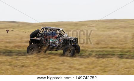 Atv Vehicle On A Dirt Road Through The Fields.