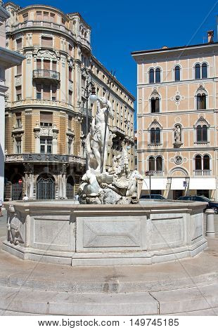 Trieste Italy 26 August 2016: Neptune fountain in Stock Market square Trieste Italy