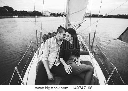 Pretty Couple Outdoor  Relaxing On The Yacht