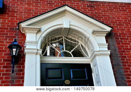 Philadelphia Pennsylvania - June 25 2013: Elegant 18th century colonial doorway with fan window in historic Headhouse Square
