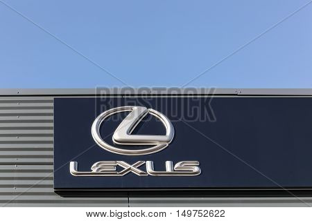Aarhus, Denmark - February 13, 2016: Lexus logo on a wall. Lexus is the luxury vehicle division of Japanese automaker Toyota