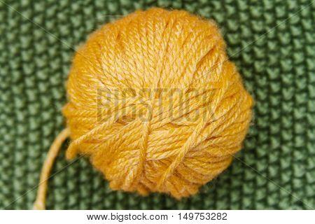 Yellow Ball Of Wool On Green Cloth Woven Wool