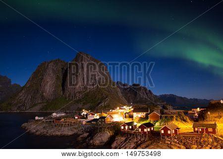 Aurea Borealis over the fishing village of Hamnoy Lofoten Norway