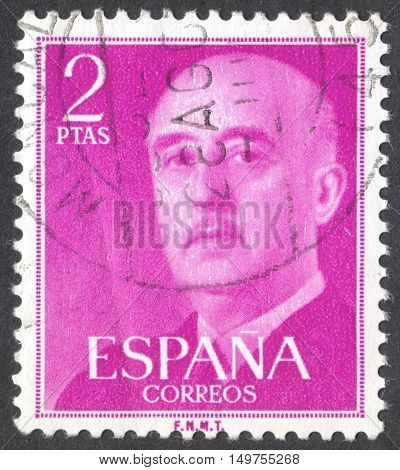 MOSCOW RUSSIA - CIRCA SEPTEMBER 2016: a stamp printed in SPAIN shows a portrait of Francisco Franco the series circa 1955