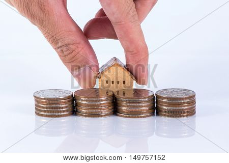 House, coins stack and hand, realestate concept
