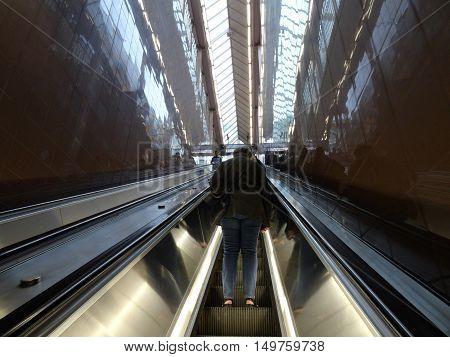 SEATTLE - JUNE 24: People ride escalator up out of Pioneer Square transit station. taken Seattle Washington on June 24 2016.