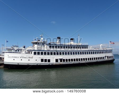 SAN FRANCISCO CA - SEPTEMBER 14: California Hornblower docked in the San Francisco Bay. Hornblower cruises are a local favorite for dinner cruises Bay tours weddings and corporate events. September 14 2009 San Francisco CA.