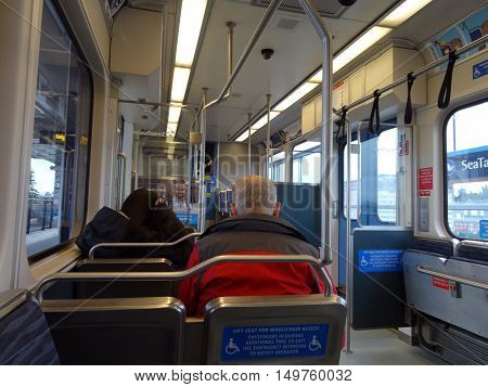 SEATTLE - JUNE 24: People ride Sound Transit light rail train from the Seattle Airport to the city taken Seattle Washington on June 24 2016.