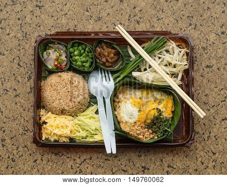 Thai cuisine. lunch box set on a background Thai food pad thai and Fry rice with the shrimp paste