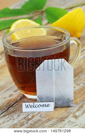 Welcome card with glass of tea and tea bag leaning against it