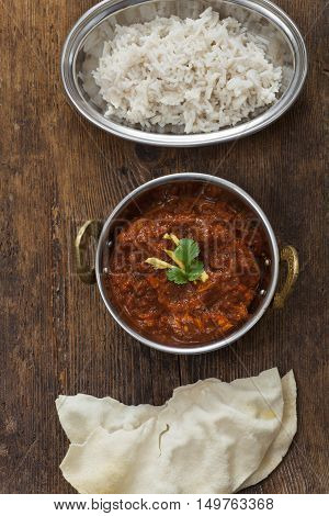 overview of indian chicken curry in a pot