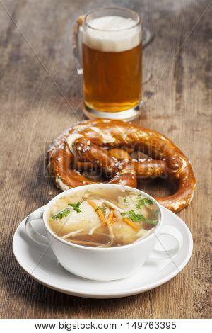 bavarian semolina dumplings in broth on wood