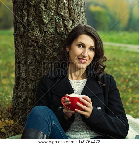Portrait of beautiful smiling woman on nature