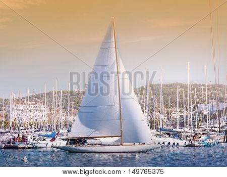 CANNES, FRANCE - 19 SEPTEMBER, 2016:   Old Port Vieux Port in the city of Cannes, with lots of sailing boats and power yachts anchored during the Sailing regatta