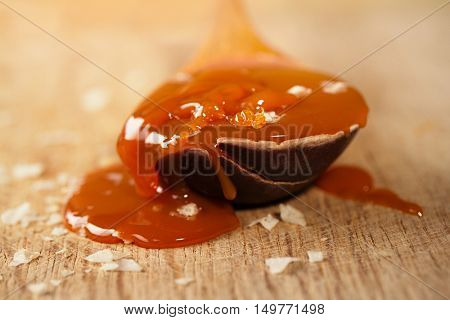 salted caramel in old wooden spoon