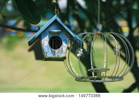 Bird house on a tree branch in the garden