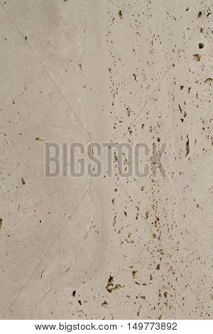 Closeup on beige marble texture with scars