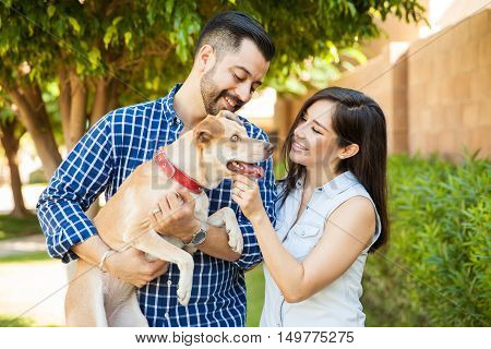 Cute Couple Petting Their Dog