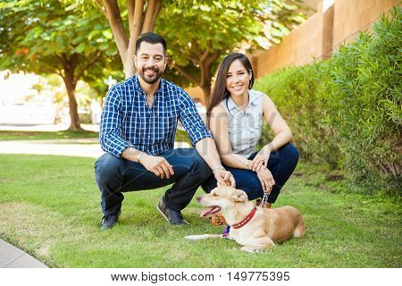 Couple Spending Some Time With Their Dog