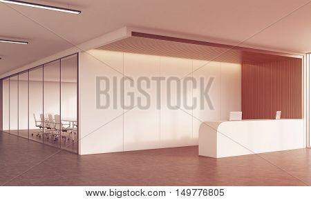 Reception Desk And Meeting Room In Sunlit Corridor