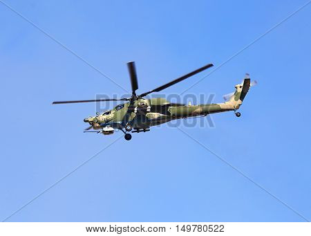 Perform flight by the modern russian attack helicopter Mi 28
