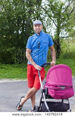 Handsome Young Man With Stroller