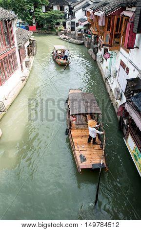China traditional tourist boats on canals of Shanghai Zhujiajiao Water Town in Shanghai China
