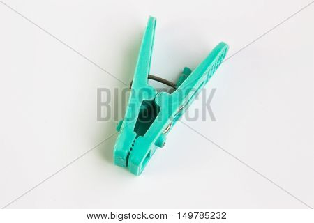 clothespins with white background / green clothes peg isolate white background with copy space