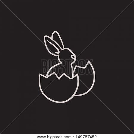 Easter bunny sitting in egg shell vector sketch icon isolated on background. Hand drawn Easter bunny sitting in egg shell icon. Easter bunny in egg shell sketch icon for infographic, website or app.
