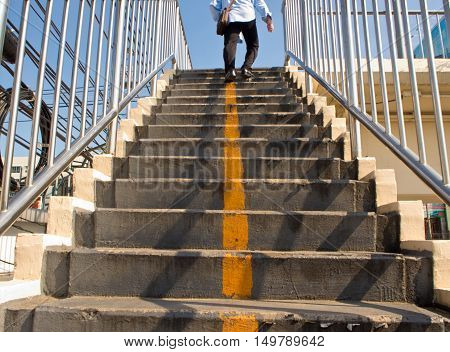 Yellow line on Concrete Stair of Overpass