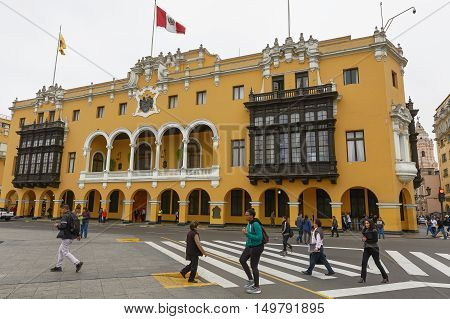 LIMA PERU - SEPTEMBER 21 2016: People and Tourists Crossing the Street at the Plaza Mayor in Lima Peru.