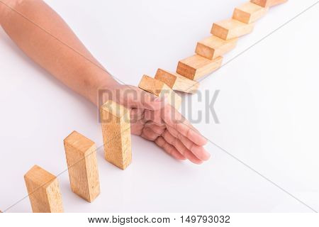 Hand Stop Wooden Block. Domino Risk Effect Concept