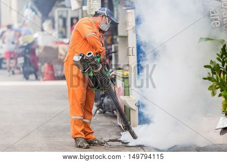 PHUKET THAILAND - AUGUST 26 2016 : The unidentified people is Fogging mosquito to prevent of dengue fever and zika virus on August 26 2016 in Phuket Thailand.