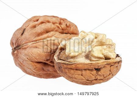 some fresh walnuts isolated on white background.