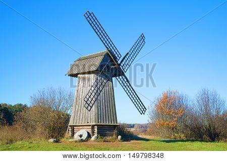 PUSHKINSKIYE GORY, RUSSIA - OCTOBER 18, 2014: Old wooden mill in the estate of Mikhaylovskoe, sunny october day.  Historical landmark of the Pushkin, Mountains