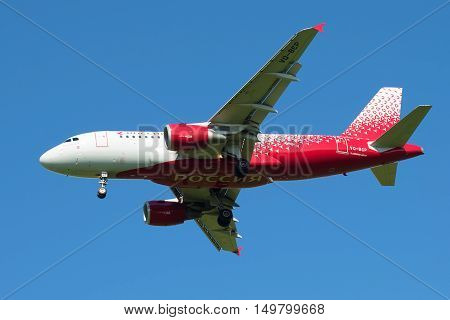 SAINT PETERSBURG, RUSSIA - AUGUST 24, 2016: Airbus A319-111 (VQ-BCP) of the airline Rossiya - Russian Airlines in the blue sky