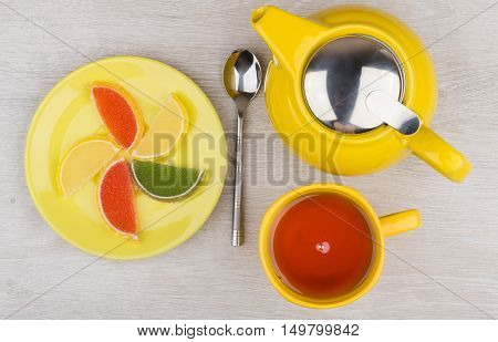 Colorful Marmalade, Hot Tea And Teapot On Wooden Table