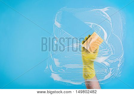 Cleaning conept - hand cleaning glass window pane with detergent and wipe or rag
