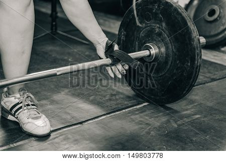 Female on weightlifting training, black and white